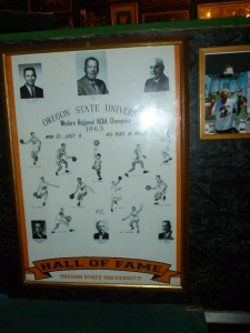 The Final Four plaque with Coach Paul Valenti's and Athletic Director, Slats Gill's pictures.