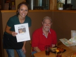 A Beerchaser tradition at each stop - a photo of the logo - Shelby and Dave Booher at the Solstice Brew Pub in Prineville