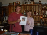 Brewmaster and Beerchaser-of-the-Month, Jonny Brose and bartender, Camas, with Thebeerchaser logo
