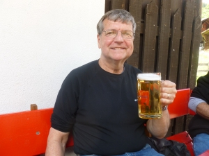 Thebeerchaser raising a mug in Amsterdam during our Rick Steves' Best of Europe Tour