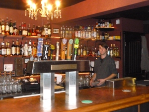 Barkeep Alex tending to business..