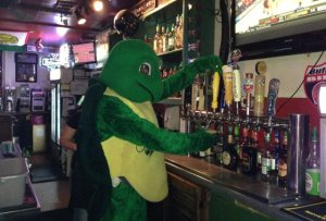 You may have one of the twelve draft beers drawn by The Cheerful Mascot.