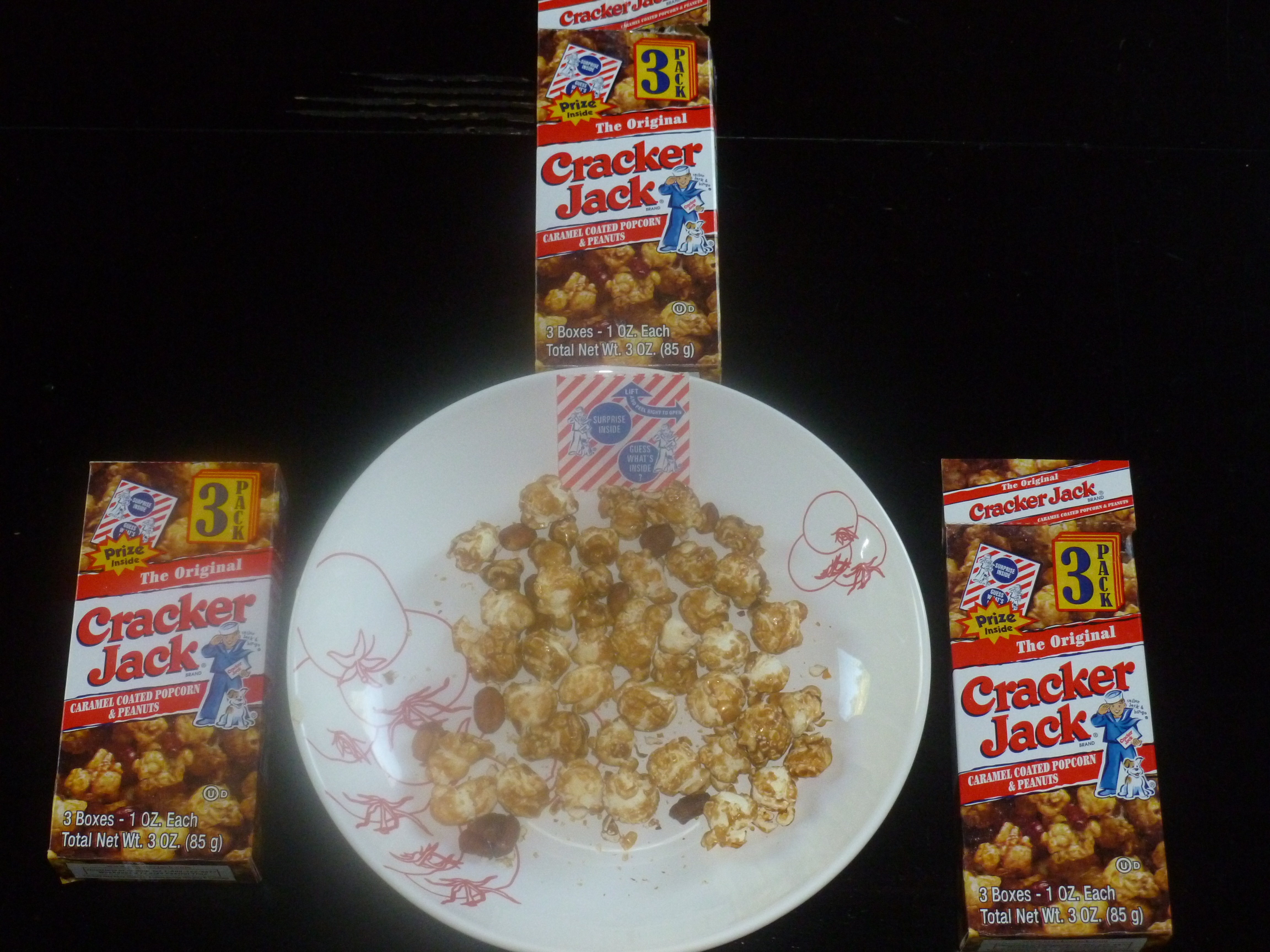 what is the name of the dog on the cracker jack box lucky