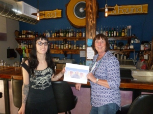 Julia the bartender with Sharon ___ Robbins and Thebeerchaser logo.
