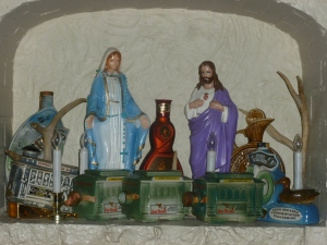 Religious statuettes and old whiskey trinkets - tacky but quant.....