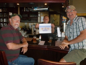 With bartender, Matt and Thebeerchaser logo at Pelican Brew Pub