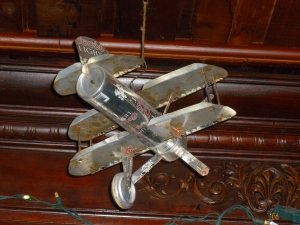 A model bi-plane made out of Coors Light can adds to the environment