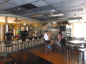 The Taproom - sparsely furnished except for the beers on tap