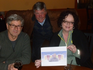 Roy Lamber, Kevin Brannon and Gretchen Reuter with Thebeerchaser logo