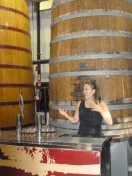 Marie enthusiastically explains barrel aging on the tour