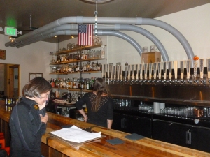 "Janet ""pouring"" over the extensive list of craft beers - notice the ""PumKing"" tap"