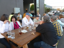 Our group sampling the food and beer after the walk around the neighborhood