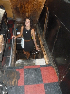 Mary Kate opened the trap door and shows the steps descending to the cellar