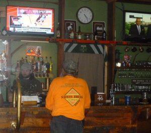 """TJ, the bartender, serving """"Murph: - a Ranger Station regular"""