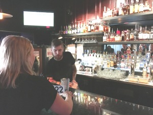 ___ the friendly bartender at work